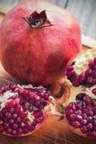 Raw pomegranates Stock Images