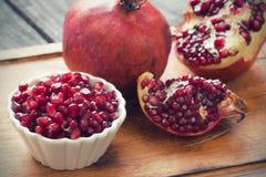 Raw pomegranates Royalty Free Stock Photos