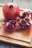 Raw pomegranates Stock Image