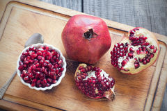 Raw pomegranates Royalty Free Stock Photo