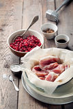 Raw pork in a bowl, cranberries, seasonings and meat hammer Royalty Free Stock Photo