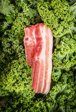 Raw Pork brisket  and kale, top view. Raw Pork brisket  and kale prepared, top view Stock Photo