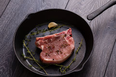 Raw pork chop in pan Royalty Free Stock Photography