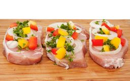 Raw pork chop with vegetables Stock Images