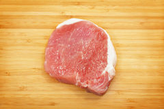 Raw pork chops. On a cutting board Stock Photography