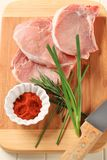 Raw pork chops Stock Images