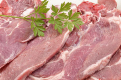 Raw pork chops. With parsley Royalty Free Stock Photography