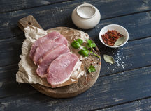 Free Raw Pork Chops And Spices On A Rustic Wooden Cutting Board Royalty Free Stock Images - 68954069