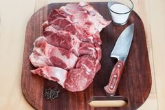Raw pork chops. Arrangement on a cutting board. Royalty Free Stock Image