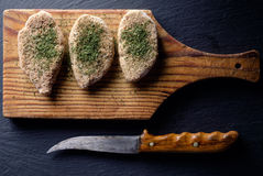 Raw pork chops. Pork chops on a cutting board. Selective focus Stock Photo