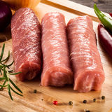Raw pork chops. On cutting board and vegetables Royalty Free Stock Photos