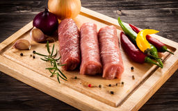 Raw pork chops. On cutting board and vegetables Royalty Free Stock Photography