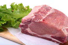 Raw pork chops with herbs and spices on cutting board. Ready for cooking. Stock Photo