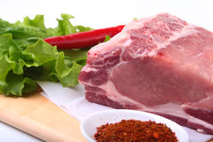 Raw pork chops with herbs and spices on cutting board. Ready for cooking. Stock Image