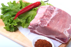 Raw pork chops with herbs and spices on cutting board. Ready for cooking. Royalty Free Stock Photos