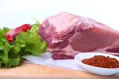 Raw pork chops with herbs and spices on cutting board. Ready for cooking. Royalty Free Stock Images