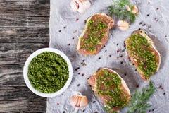 Raw pork chops marinated with pesto sauce Stock Image