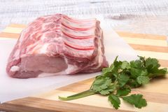 Raw pork chops, spices and basil on cutting board. Ready for cooking. Stock Images