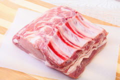 Raw pork chops, spices on cutting board. Ready for cooking. Royalty Free Stock Photography