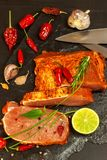 Raw pork chops with spices. Sliced meat prepared on the grill. Stock Photo