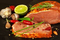 Raw pork chops with spices. Sliced meat prepared on the grill. Royalty Free Stock Photos