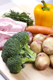 Raw pork chops and vegetables Stock Photo