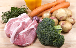 Raw pork chops and vegetables Stock Photography