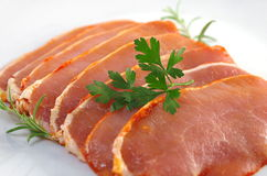 Raw pork chops. On white plate Stock Photo