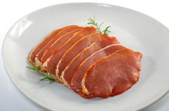Raw pork chops. On white plate Stock Image