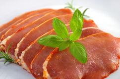Raw pork chops. On white plate Stock Photography