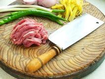 Raw pork and condiments Stock Photos