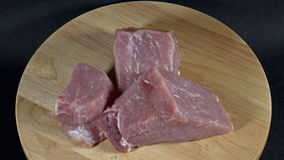 Raw pork cut is rotating show stock footage