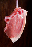 Raw pork cutlet close up. on wooden background Stock Photo