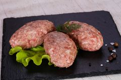 Raw pork cutlet. Minced meat Royalty Free Stock Images