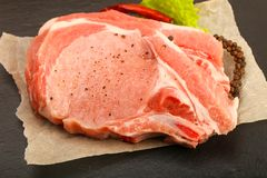 Raw pork cutlet. With pepper and salt ready for cooking Royalty Free Stock Images