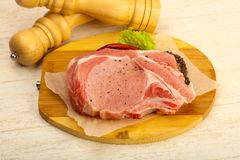 Raw pork cutlet. With pepper and salt ready for cooking Royalty Free Stock Photos