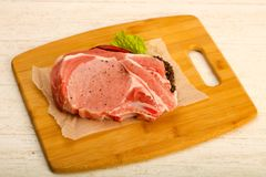 Raw pork cutlet. With pepper and salt ready for cooking Royalty Free Stock Photography