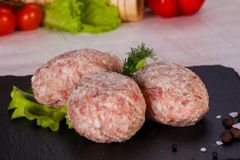 Raw pork cutlet. Minced meat Royalty Free Stock Photography