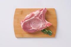 Raw pork cutlet Stock Photos