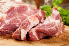 Raw pork on cutting board Stock Photography