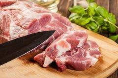 Raw pork on cutting board. Fresh raw pork on cutting board Stock Photos