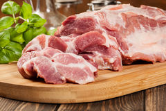 Raw pork on cutting board Royalty Free Stock Photography
