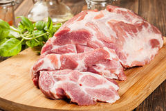 Raw pork on cutting board Royalty Free Stock Images