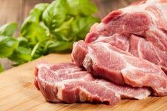 Raw pork on cutting board. Fresh raw pork on cutting board Royalty Free Stock Image