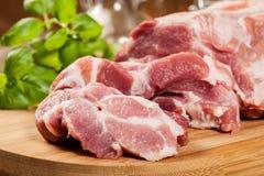 Raw pork on cutting board Stock Photos