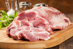 Raw pork on cutting board Stock Images