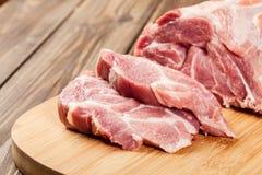 Raw pork on cutting board. Fresh raw pork on cutting board Stock Images