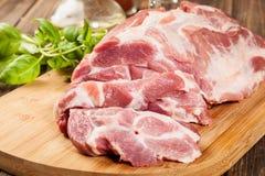 Raw pork on cutting board. Fresh raw pork on cutting board Stock Image