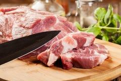 Raw pork on cutting board. Fresh raw pork on cutting board Royalty Free Stock Images