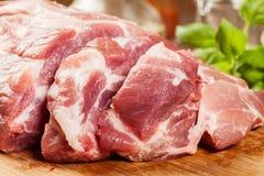 Raw pork on cutting board Royalty Free Stock Photos